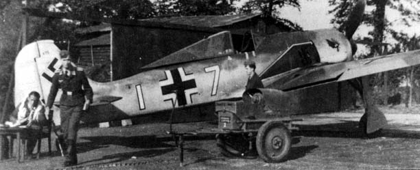Staffelkapitän of 7./JG 2 Oblt. Egon Mayer beside the tail of his Fw 190A-3 (probably W.Nr.435) White 7. June/July 1942.