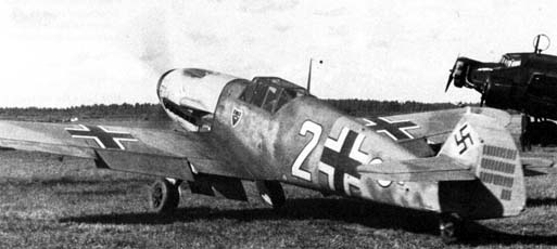 Lt. Ostermann of 7./JG 54 preparing to take off with his Bf 109 F-4 White 2. His rudder tally shows 33 victories. Russia, September 1941.