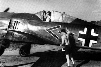 Major Gerd Schöpfel in his Fw 190A-2 after return from combat sortie. St. Omer, early 1942.