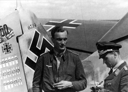 "Oberleutnant Josef Wurmheller, Staffelkapitän 9./JG 2, was photographed, beside his Fw 190 A-6 (W.Nr. 530314) ""Yellow 2"", in August/September"